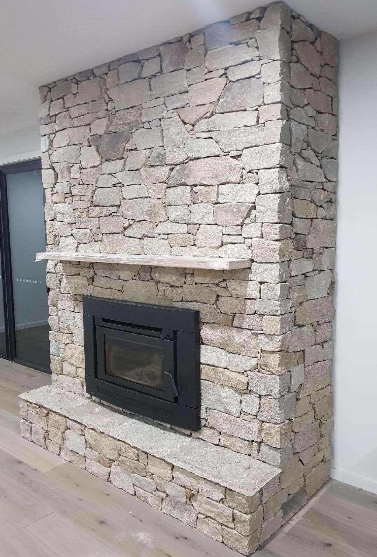 Fireplace build with Franklin irregular stone cladding seen in a stone house