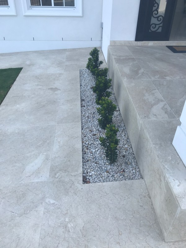 Exterior house flooring and staircase designed with Gundy marble flooring tiles and pavers