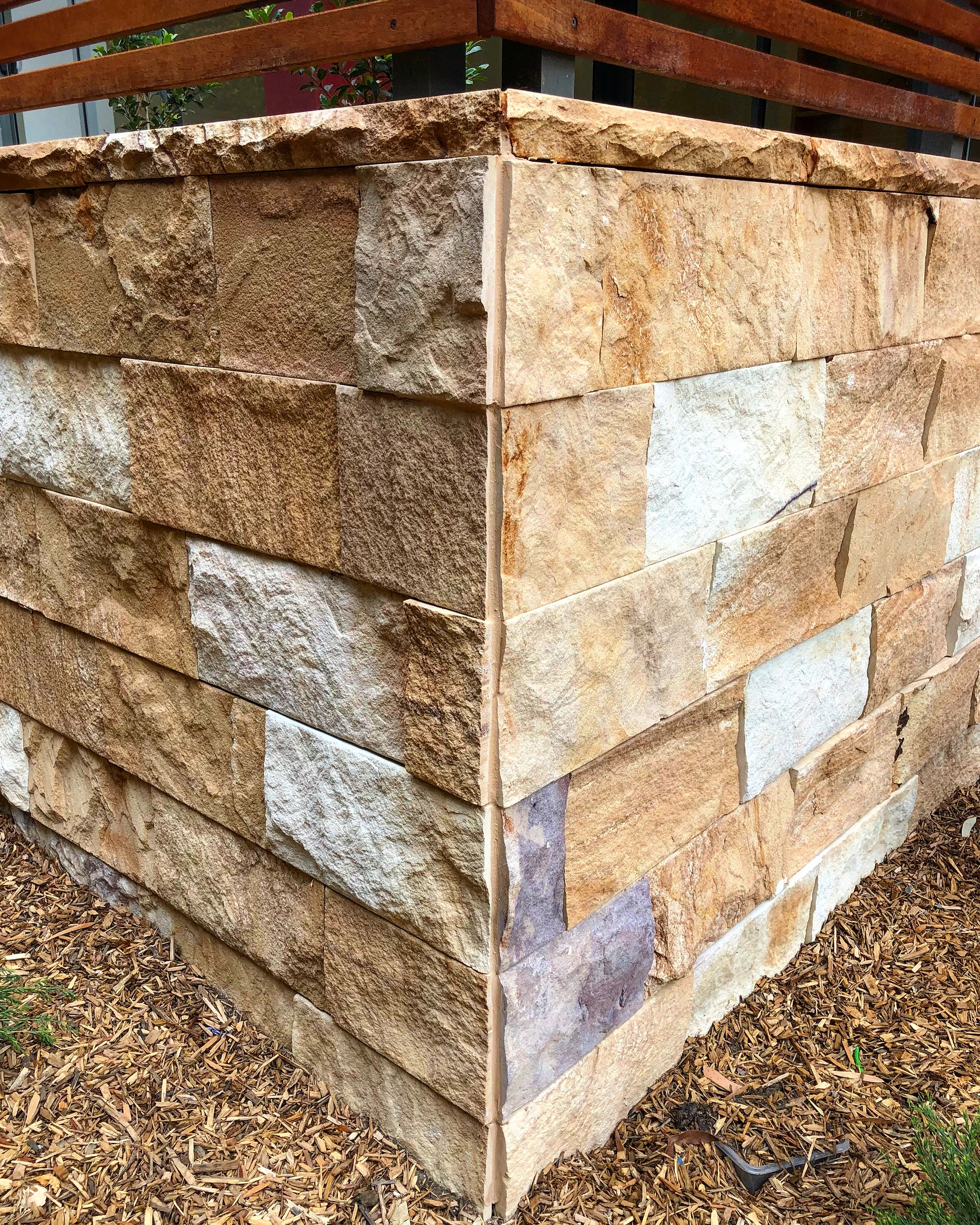 Natural split face kirra Ranch wall stone claddings and capping stones used in a house wall