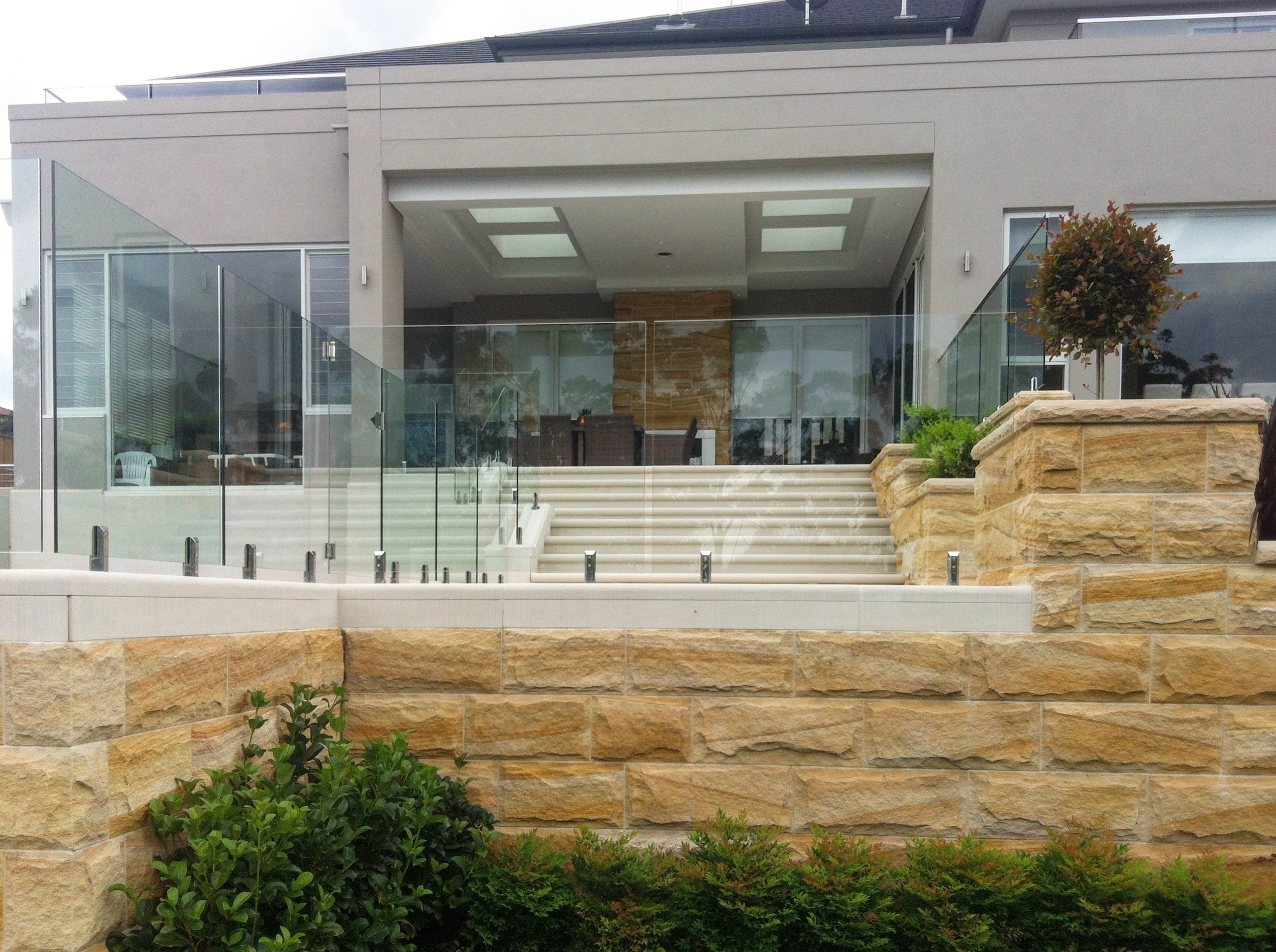 Residential building with a nice stone wall using rockface stone