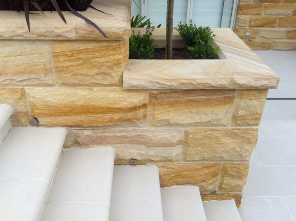 Landscape design of a garden with Aussietecture rockface stone walling and garden edging stone