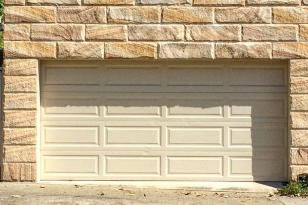 A stone garage designed with rock face banded sandstone from Aussietecture stone supplier