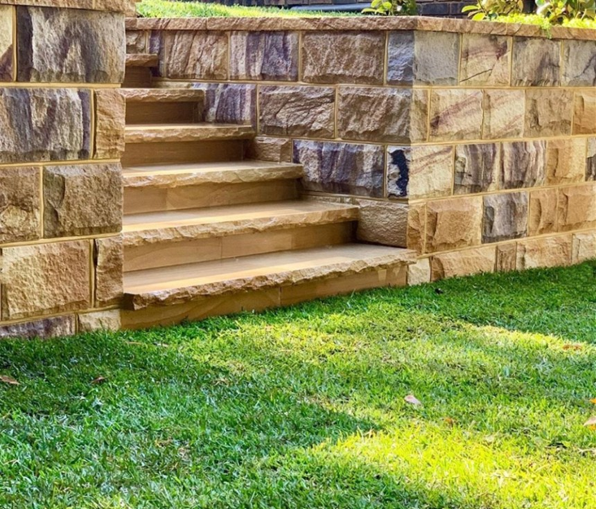 Landscape project, stone walls and stone stairs, using split blocks ranch and capping stones, rockface finish