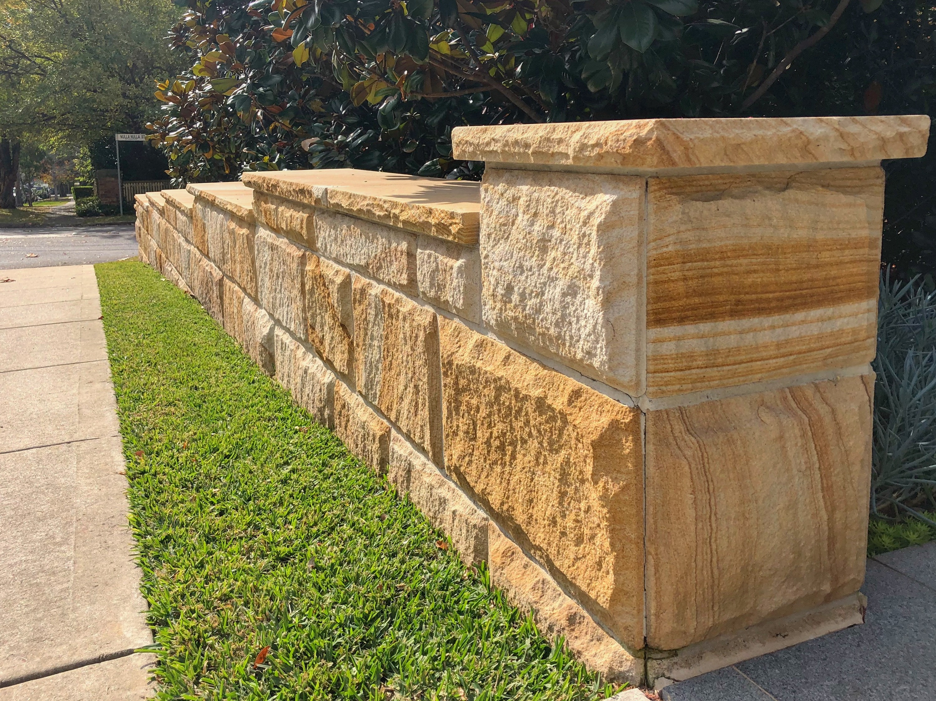 Landscape design using rock face sandstone walling and capping stone