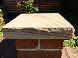 Banded stone capping seen in a Landscaping project