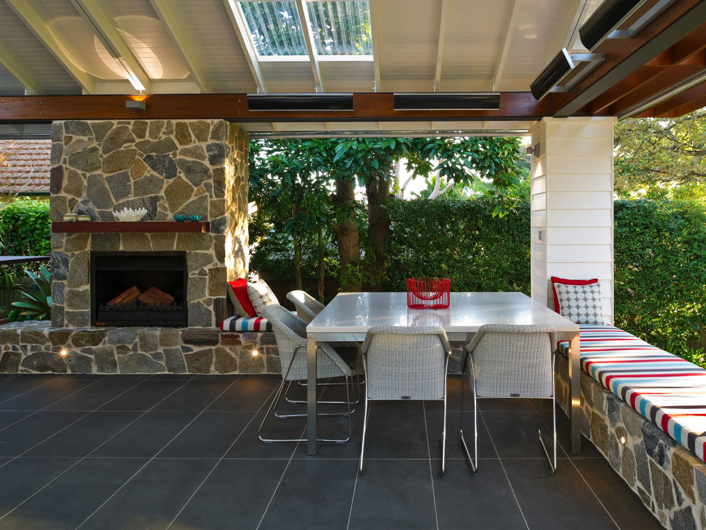 A stone fireplace and walls using Tilpa wall claddings and some furniture Exterior barbeque place