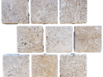 Travertine cobblestone pavers seen in a pattern design with mesh back