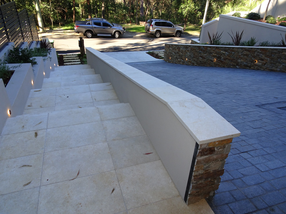 Residential outdoor staircase using appin stone pavers and coping stones