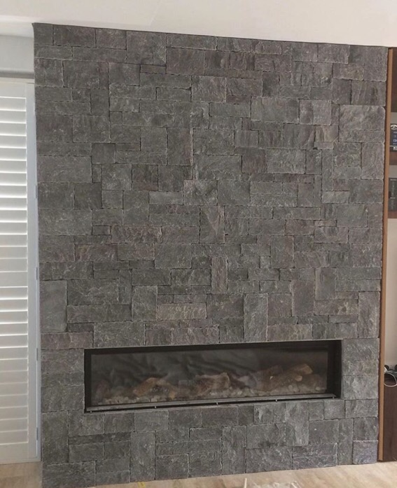 A fireplace project using Weipa stone walling as Cladding in a commercial house
