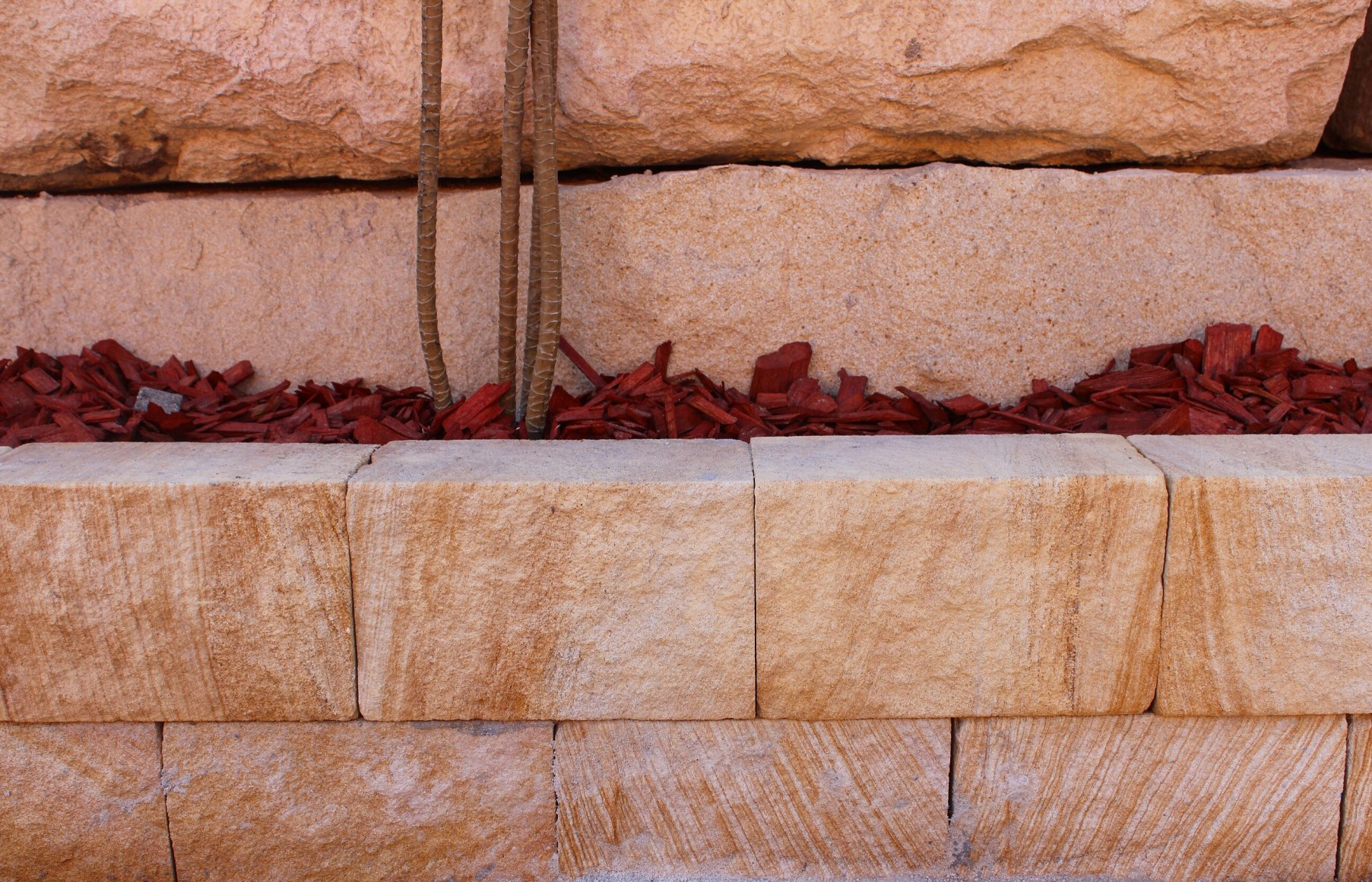 landscape design of a retaining wall and garden edging use Australian sandstone blocks