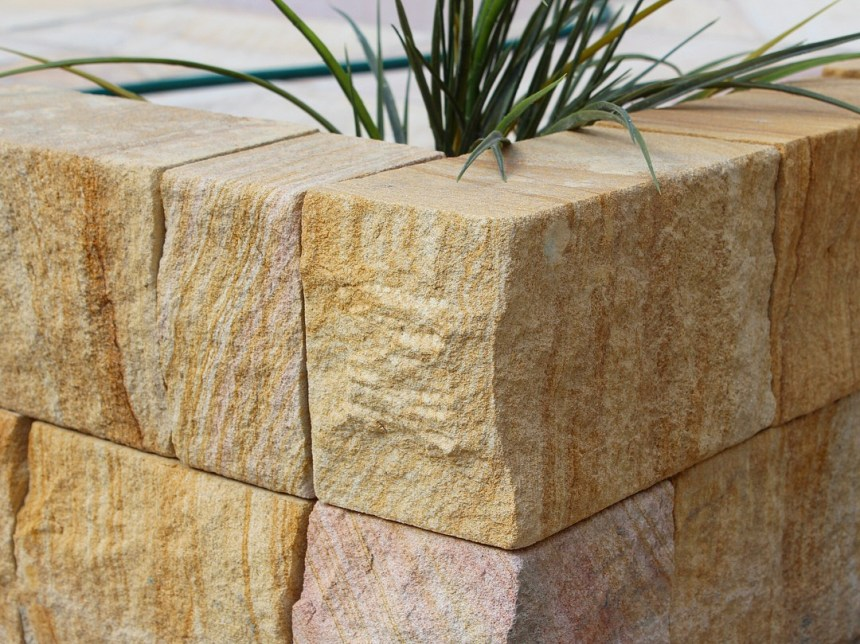 Landscape design of a Garden edging project using Australian sandstone split block