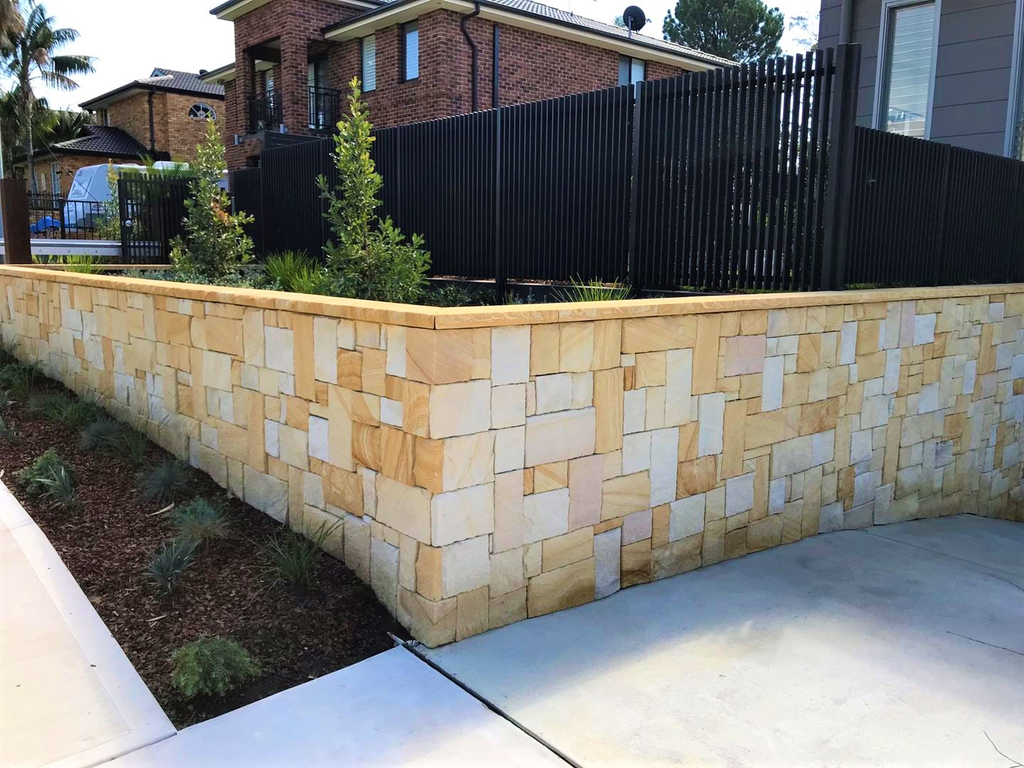 A residential retaining wall design using Australian Stone walling