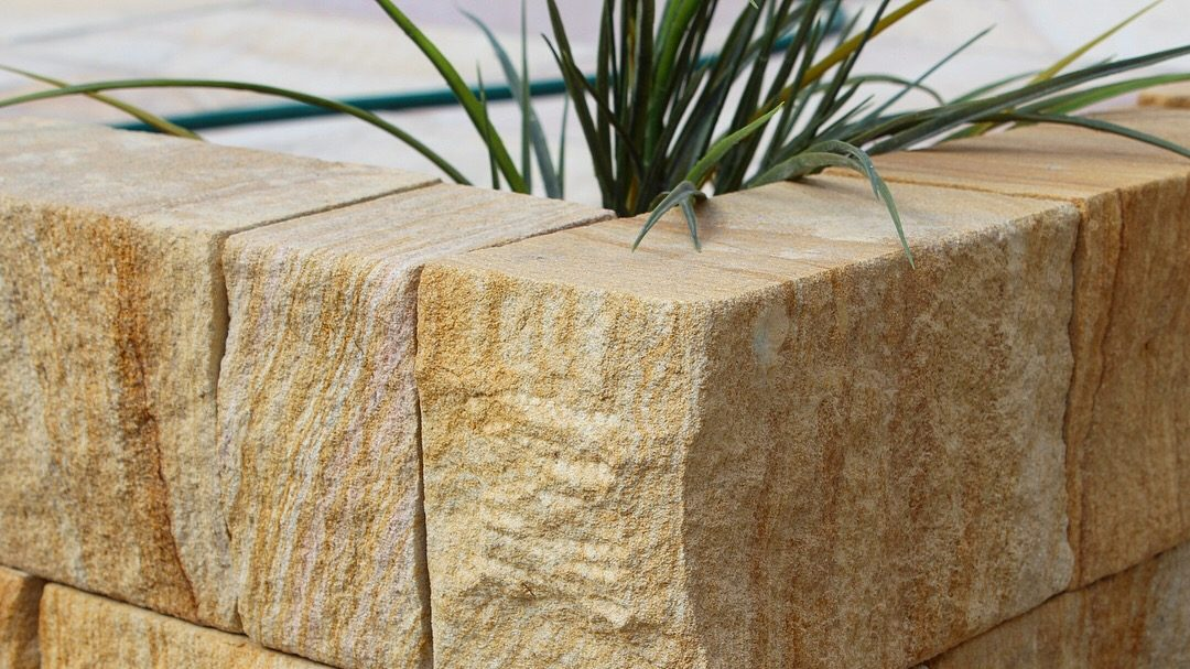 Landscape design of a garden using Australian sandstone bricks as garden edging