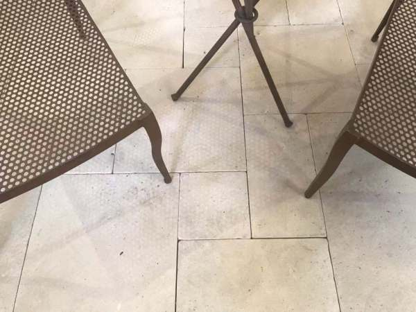 exterior tumbled limestone flooring tiles and pavers with some furniture