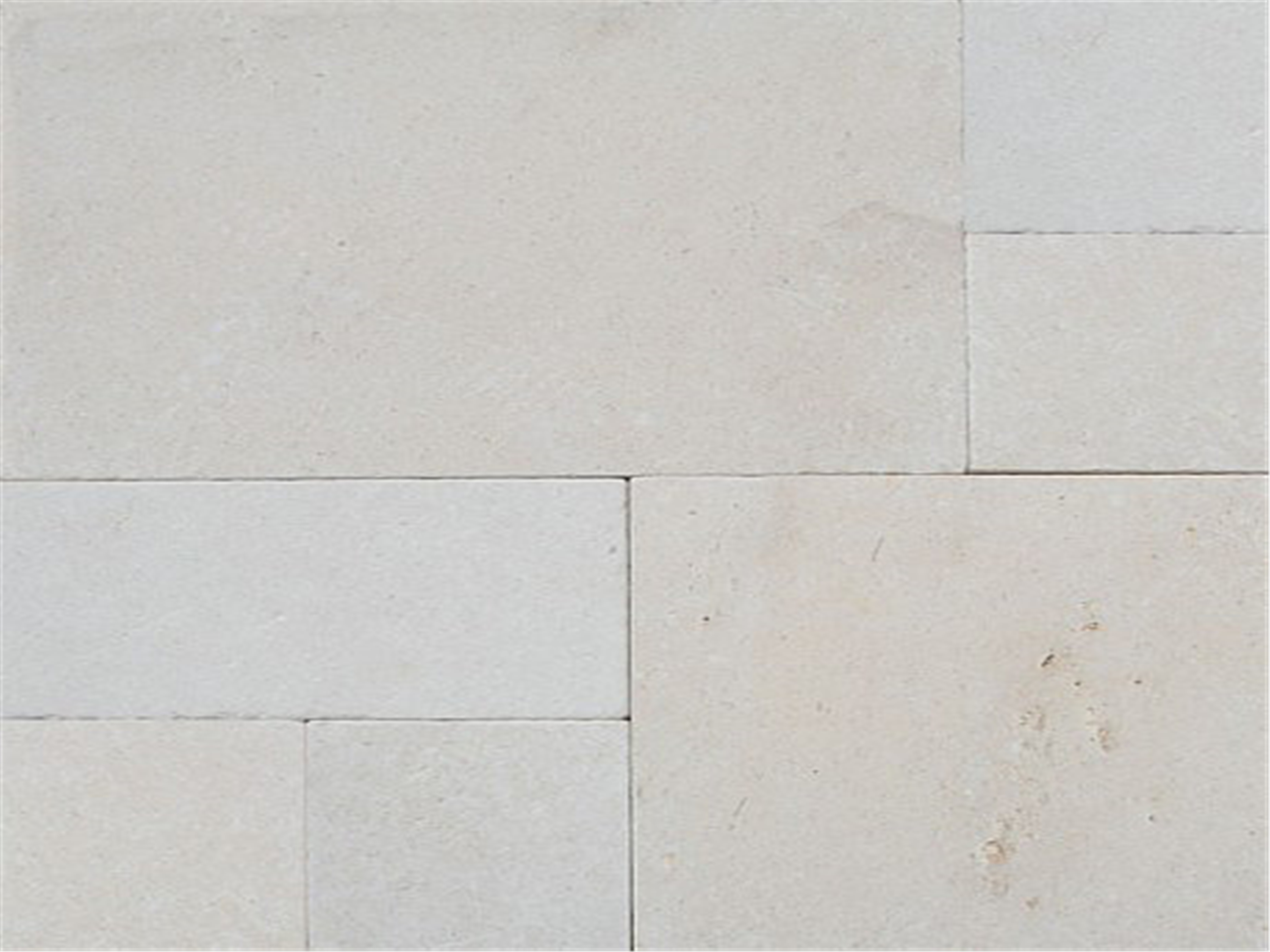 Derby limestone tumbled pavers laid in French pattern for house flooring