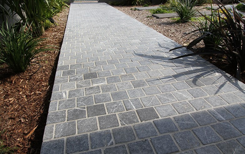 Landscape design of a garden path using cobblestone paver bindoon limestone