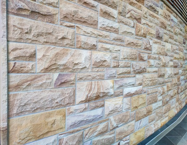 A commercial feature wall design in surfer's paradise using rockface ranch Stone walling