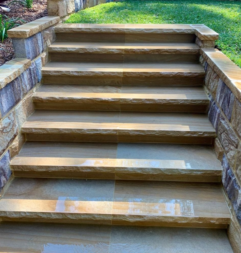 Stone stairs and stone capping using Australian local source sandstone seen in outdoor landscaping design