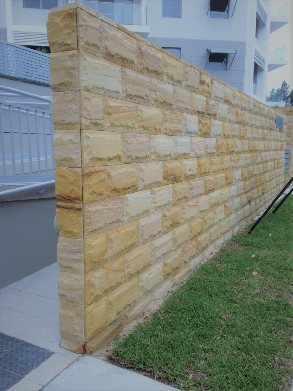 Exterior stone wall project designed with Aussietecture rockface sandstone cladding