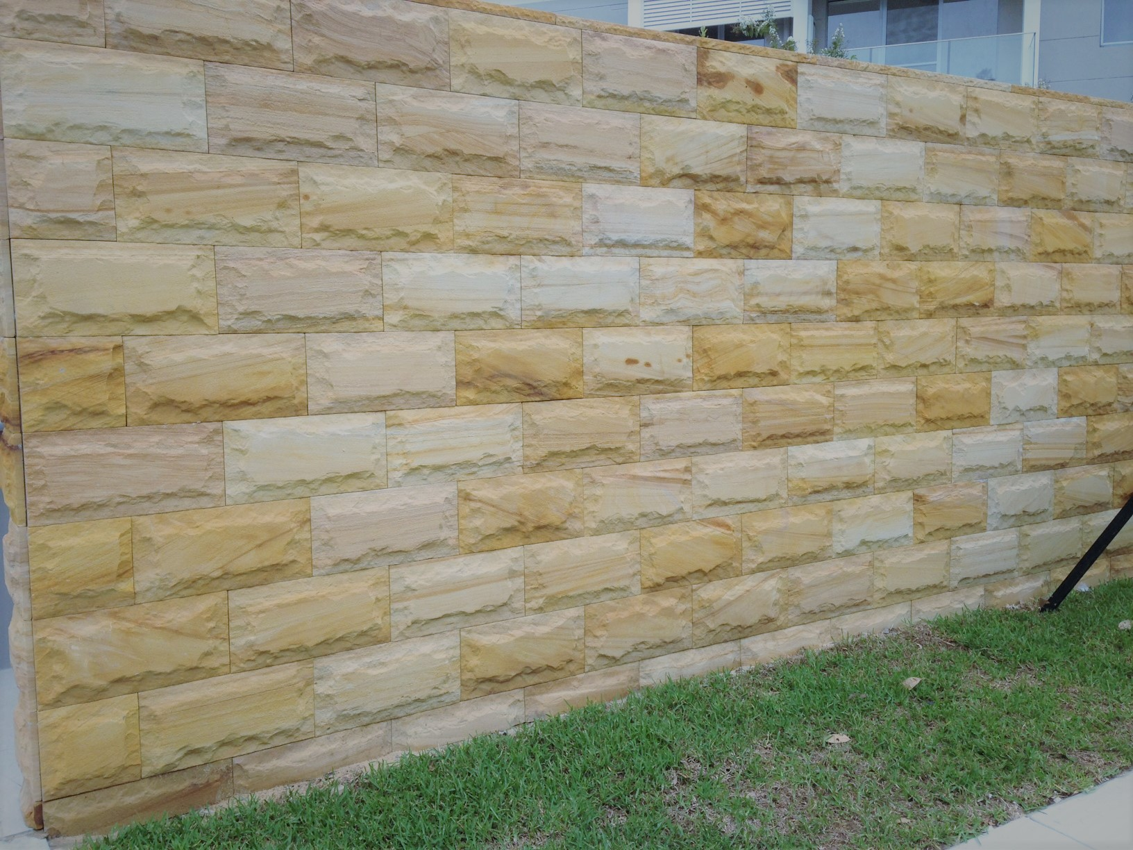 Exterior stone wall project designed with Aussietecture rock face sandstone