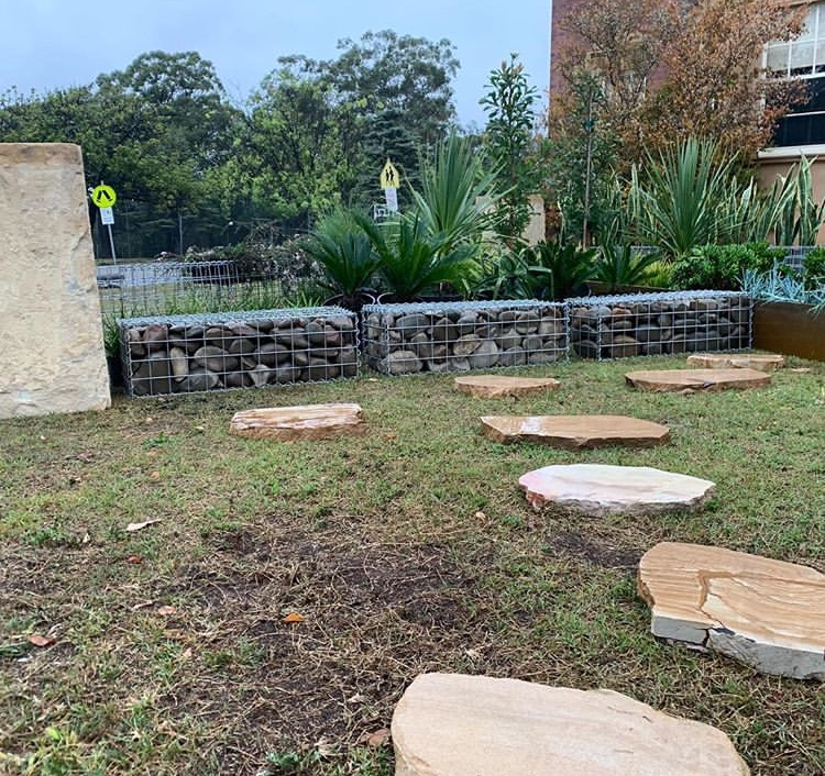 Landscape project of Stone steppers formed a path on a residential lawn