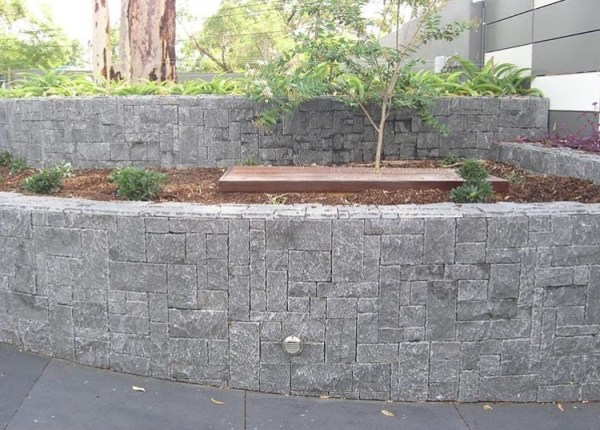 Landscape design of a garden using Weipa stone walling as garden edging