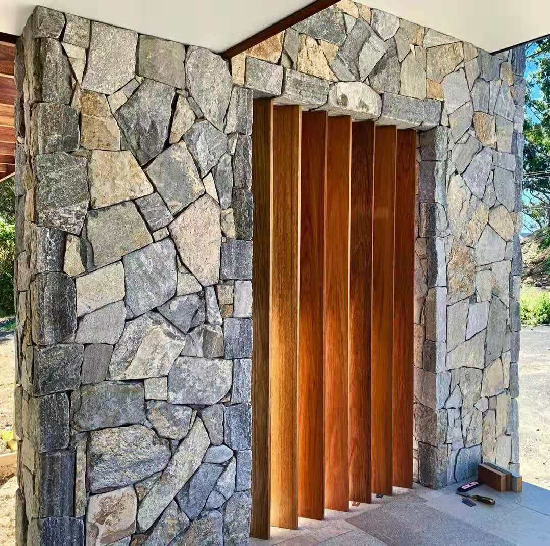 Eyre irregular walling stone with timber door seen in a residential home design project