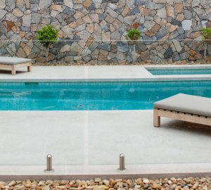 Swimming pool project using mosaic pool tile and Eyre limestone wall cladding