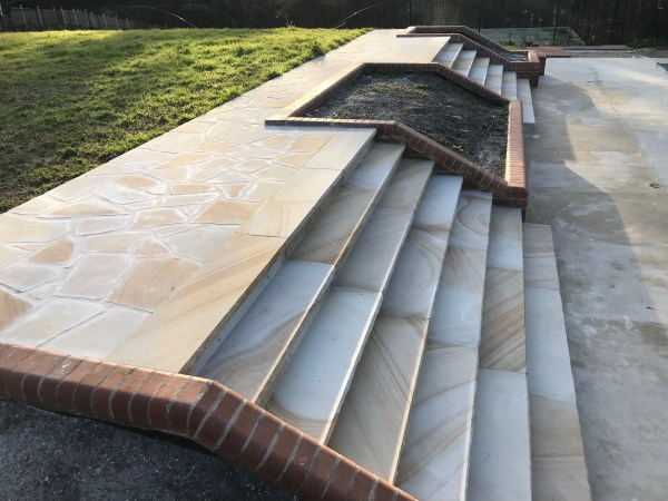 Banded Sandstone Crazy paving and sandstone treads in a landscaping project