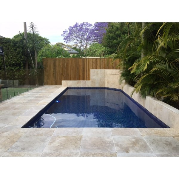 Travertine paver in residential swimming pool flooring