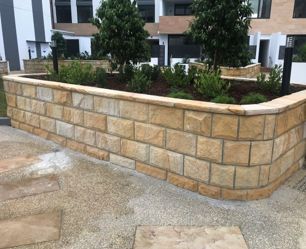 Rock face sandstone wall cladding in a landscaping project
