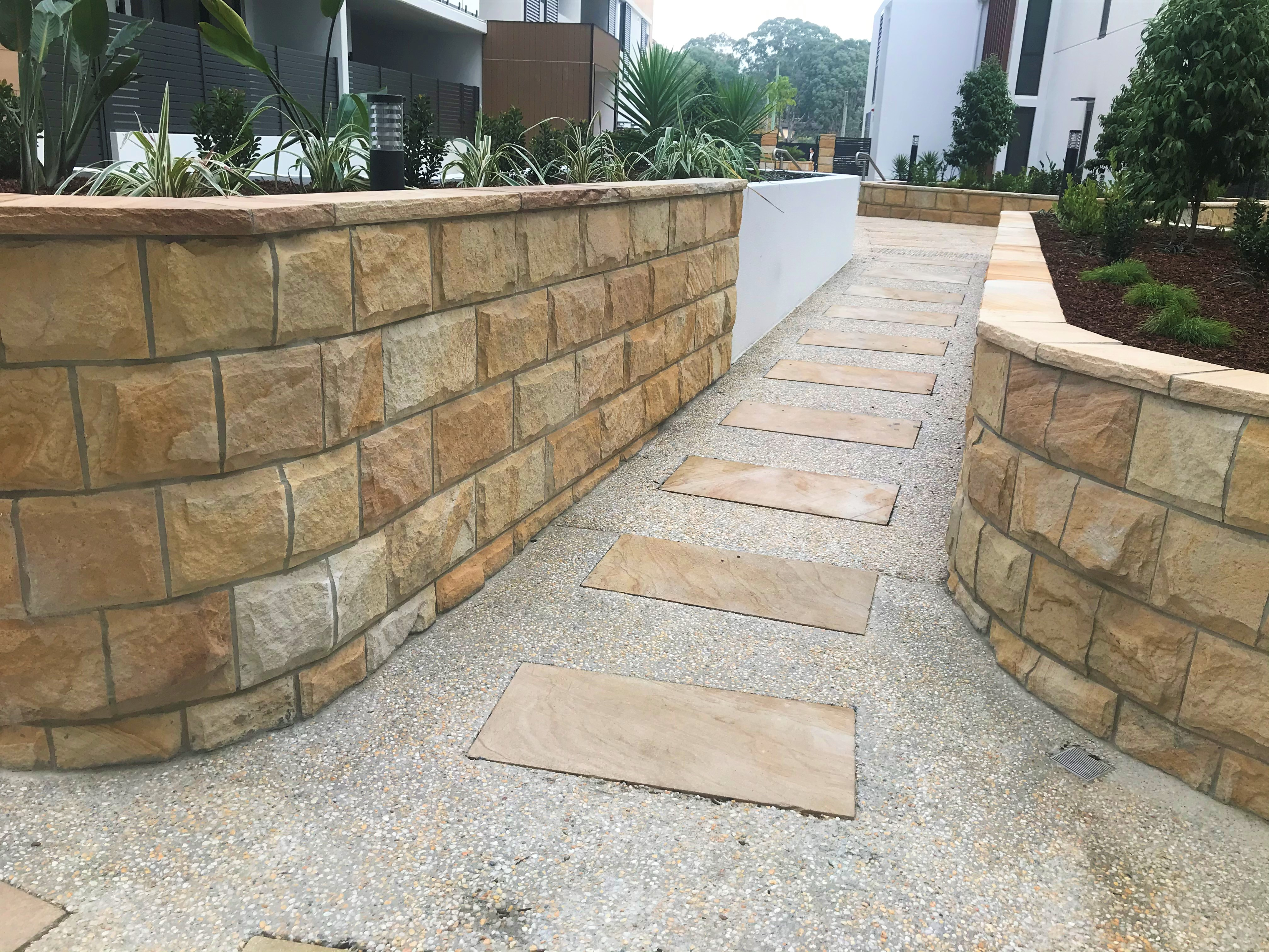 Sandstone rockface cladding , stepping stone & capping stone