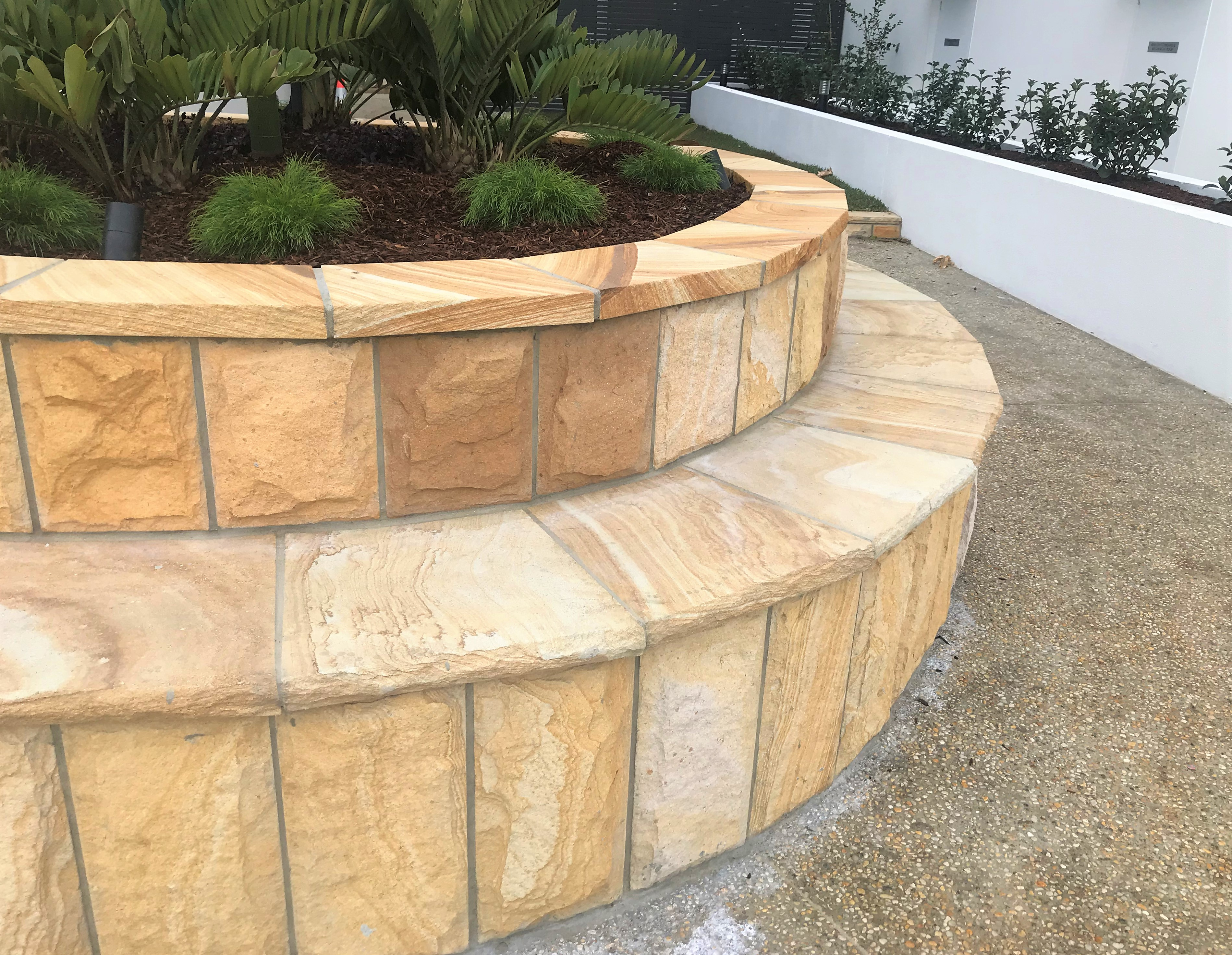 Sandstone rockface cladding & Capping in a garden project