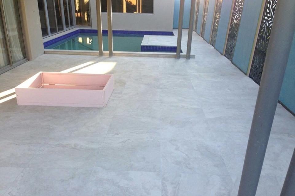 Urban series porcelain silver travertine in swimming pool area
