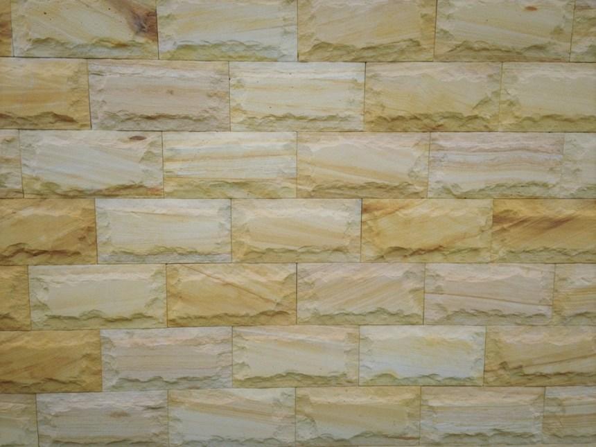 rockface sandstone in a residential walling project. Rock face sandstone