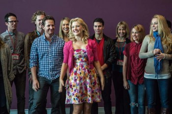 Lucy Durack lead the company in song at the first day media call