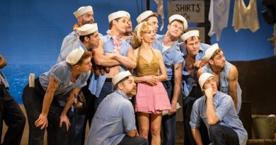 Lisa McCune and the male ensemble of South Pacific. Image by Kurt Sneddon