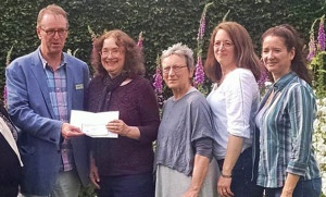 Group admins Abigail Reynolds, Susan Mason-Milks, L. L. Diamond and Maria Grace presenting a donation to Martyn Dell of Jane Austens House Museum