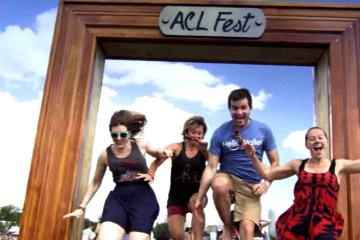 Four ACL festival-goers jump through the ACL frame at Zilker Park. Photo: Screenshot via YouTube.