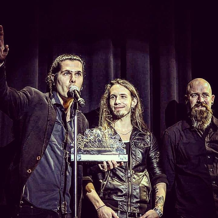 "<I>Seek Irony accepting Album of the Year at the North American Independent Rock Music Awards in 2016. <a href=""https://www.facebook.com/SeekIrony/photos/pb.6430439063.-2207520000.1458154326./10153576689149064/?type=3&theater"" target=""_blank"">Photo via Facebook</a>.</I>"
