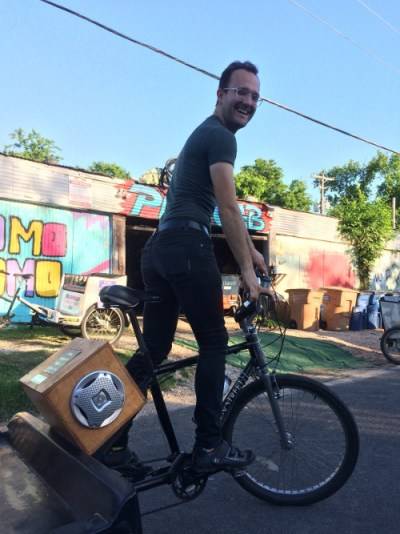 Photo: Bradley Will driving a pedicab before a Friday night shift.