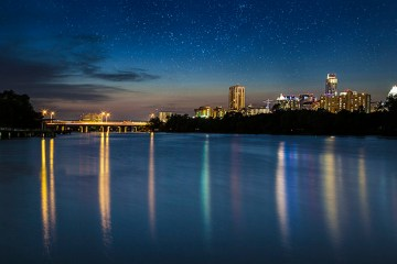 austin lady bird lake skyline bridge boardwalk bo lu