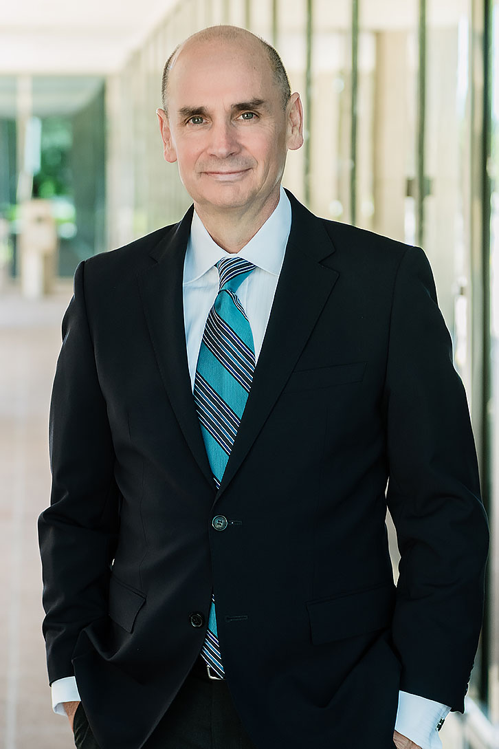 professional headshots of a businessman wearing a suit and tie