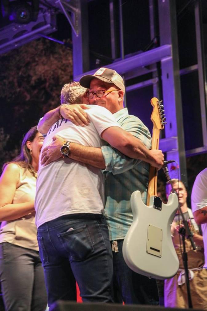 Tim hugs andrew