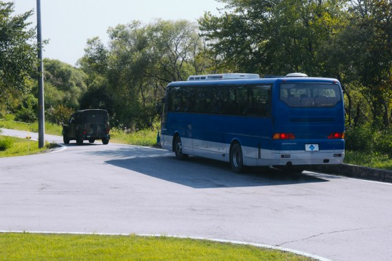 Our DMZ bus and military escort