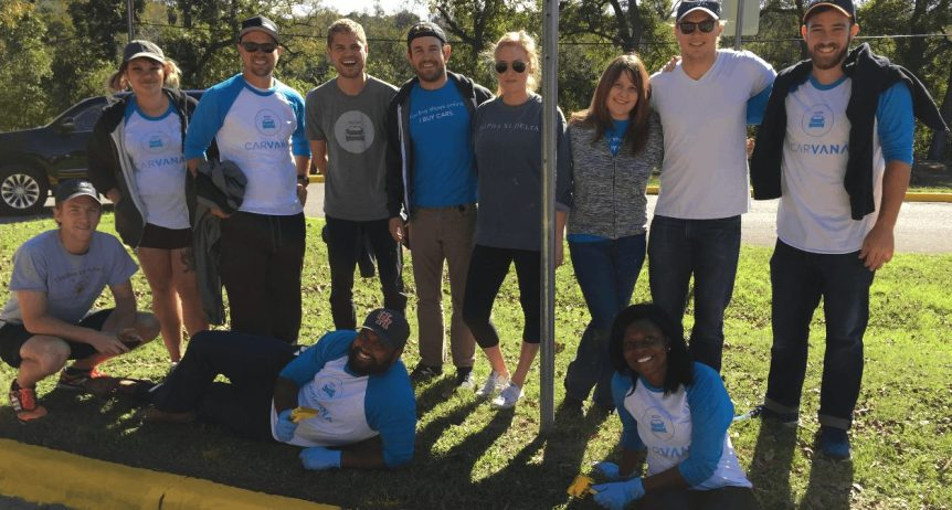 The Carvana team posing for the picture at a volunteer event