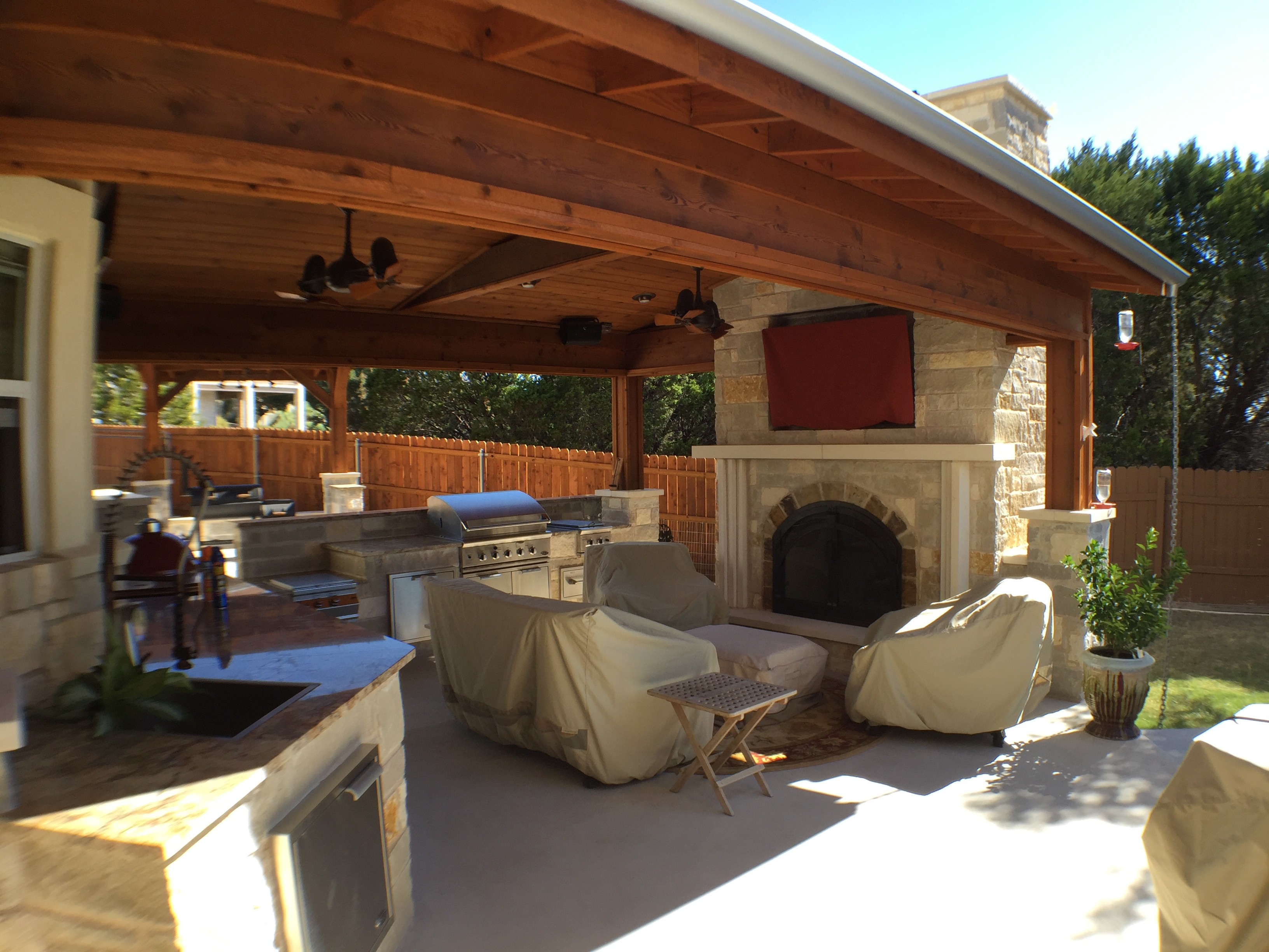 Lago Vista TX patio cover | Austin Decks, Pergolas ... on Covered Outdoor Kitchen With Fireplace id=95081