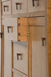 hand made walnut wood drawer pulls by Philip Morley