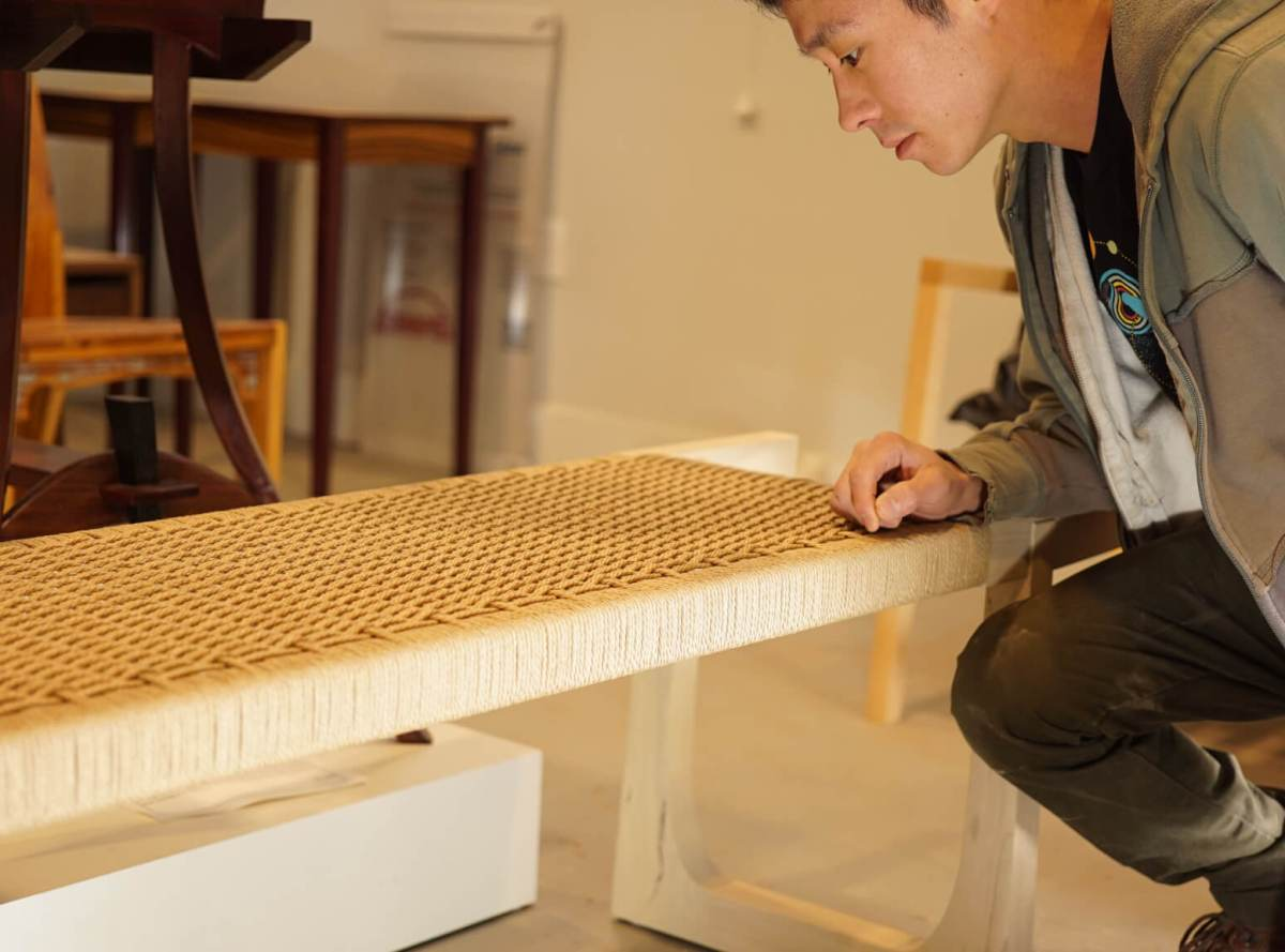 Shota yamaguchi working on custom made danish cord bench