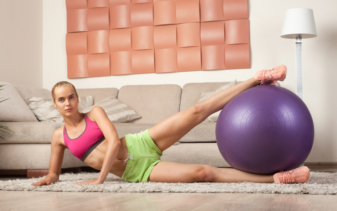 young sporty female doin aerobics at home